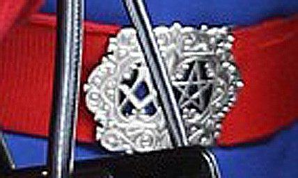 Why is Queen Elizabeth's Nurse Wearing a Masonic Belt?