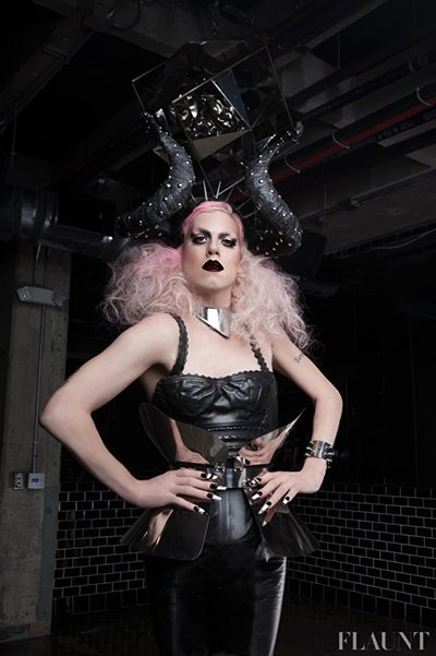 "This Flaunt magazine photoshoot features Sharon Needles who was crowned ""America's Next Drag Superstar"". The name of the photoshoot? ""Hail Satan"". Her's Sharon sporting Devil horns."