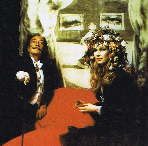Salvador Dali with a very weird image of Marilyn Monroe behind him. She died 10 years before that event. Strange way to portray her.