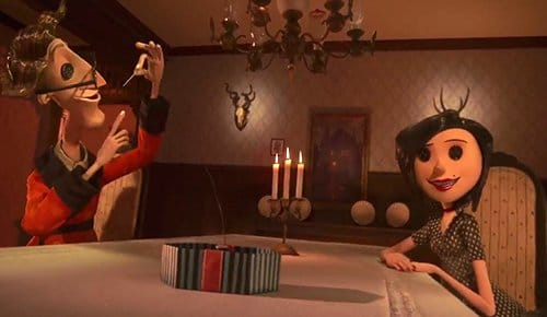 Coraline's other parents proposing her to sow buttons on her face. This creepy request represents a slave permanently escaping reality through dissociation, effectively causing them to lose their very soul. Notice the two horned (Baphomet-like) heads in the background. They are prominently lighted to emphasize the black magic/occult transformation of the MK process.