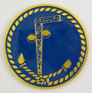 A Masonic emblem depicting two balls and a cane ... Tubal Cain.