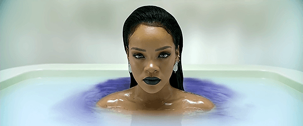 When Rihanna re-emerges, she is surrounded by blue, ink-like liquid. It appears that the process is slowly killing herself as well.