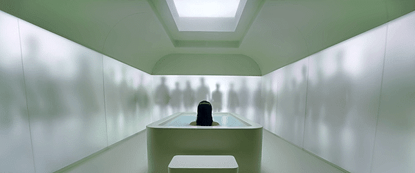 A crowd of people talking surround Rihanna who is alone in bathtub with no escape.