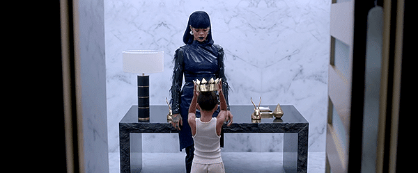 """Young Rihanna then appears and passes the crown to Initiated Rihanna. She is ready to become an """"Illuminati Queen""""."""