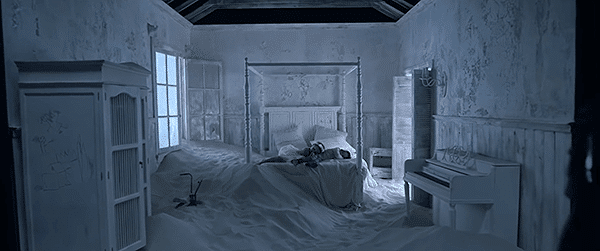 Her white room is now full of sand (deserted). The pure Rihanna in a white dress doesn't exist anymore.