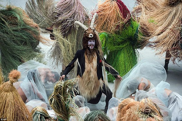 The ceremony culminated with the mass worship of a goat man.