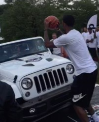 Paul George shooting over a Jeep Wrangler