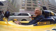 Larry Bird riding down Manhattan in an IndyCar. [Photo: PS&E]