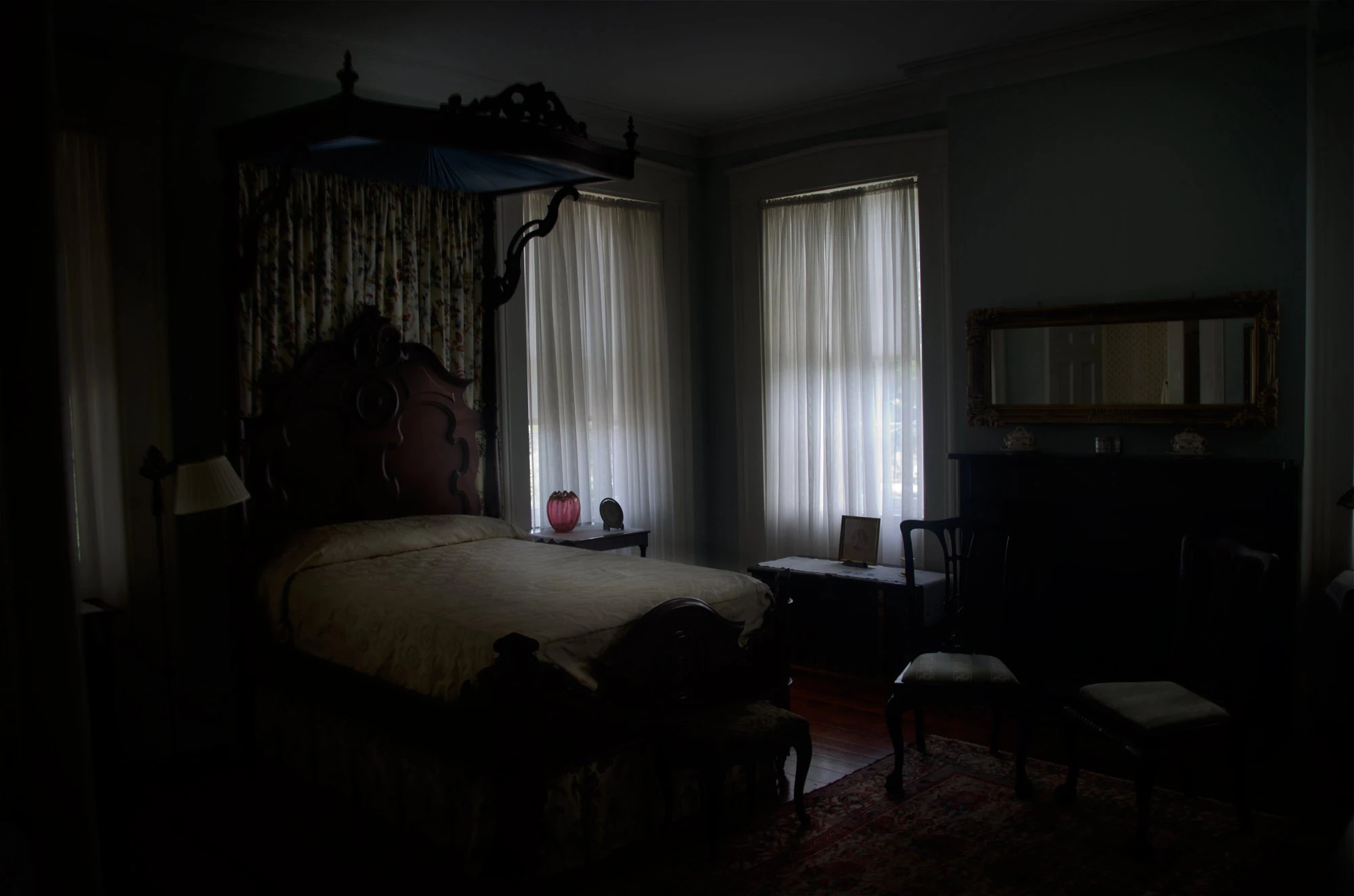 Dark Room with Window and Bed