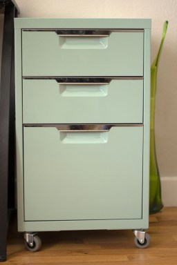 A blue filing cabinet sits beside Stephanie's desk.