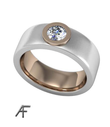 bred ring i rött och vitt guld med diamant