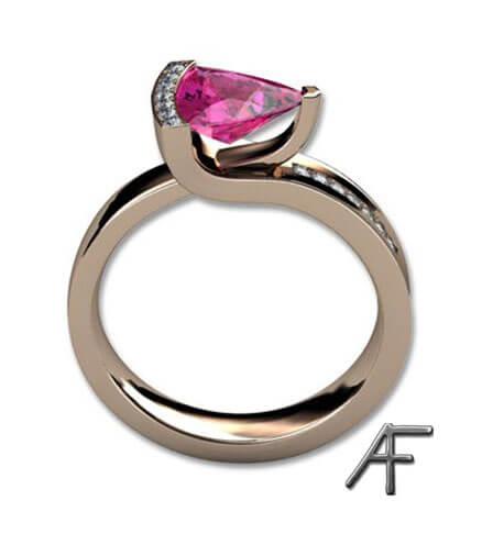 guldring med trilliantslipad rosa safir och diamanter