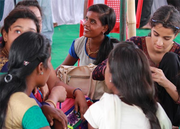 Young girls preparing labels
