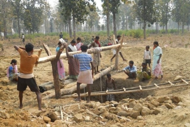 Villagers in Andhra Pradesh construct a community well under the Cloth For Work programme