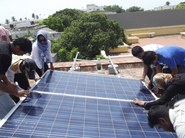 Students of SAICE actively involved in the installation of the rooftop solar power plant.