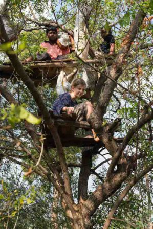 Students on a treehouse they built on their own initiative