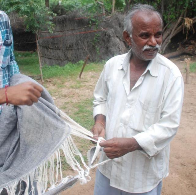 Narayan Valji Vankar with woven kala cotton cloth
