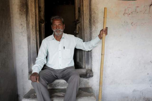 One of the 'Lathi' men with his 'Lathi'. Thavra Ram takes his turn in patrolling the land to protect it against any further degradation. In addition to having access to forest land he also has 2 hectares of private land and a few livestock.