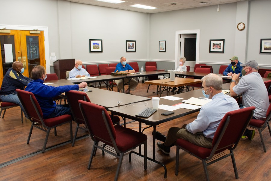 The new committee meets in a room at city hall to discuss creating a plaque about the Nathan Bedford Forrest statue.