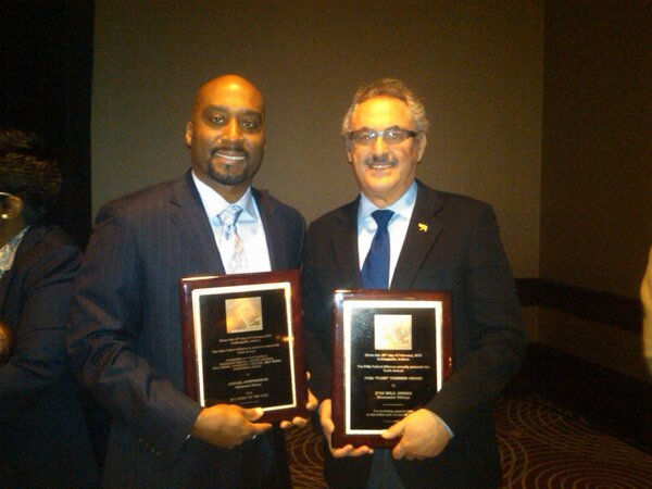 Jamaal Stephenson and Zygi Wilf as they receive their respective awards (2012 NFC Scout of the Year and the 2012 Fritz Pollard Alliance Award)