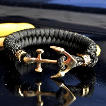 Фото плетеный браслет из паракорда с застежкой якорь и бусинами