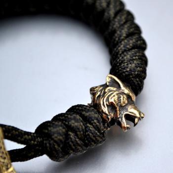 Фото браслет из паракорда с бусиной волк