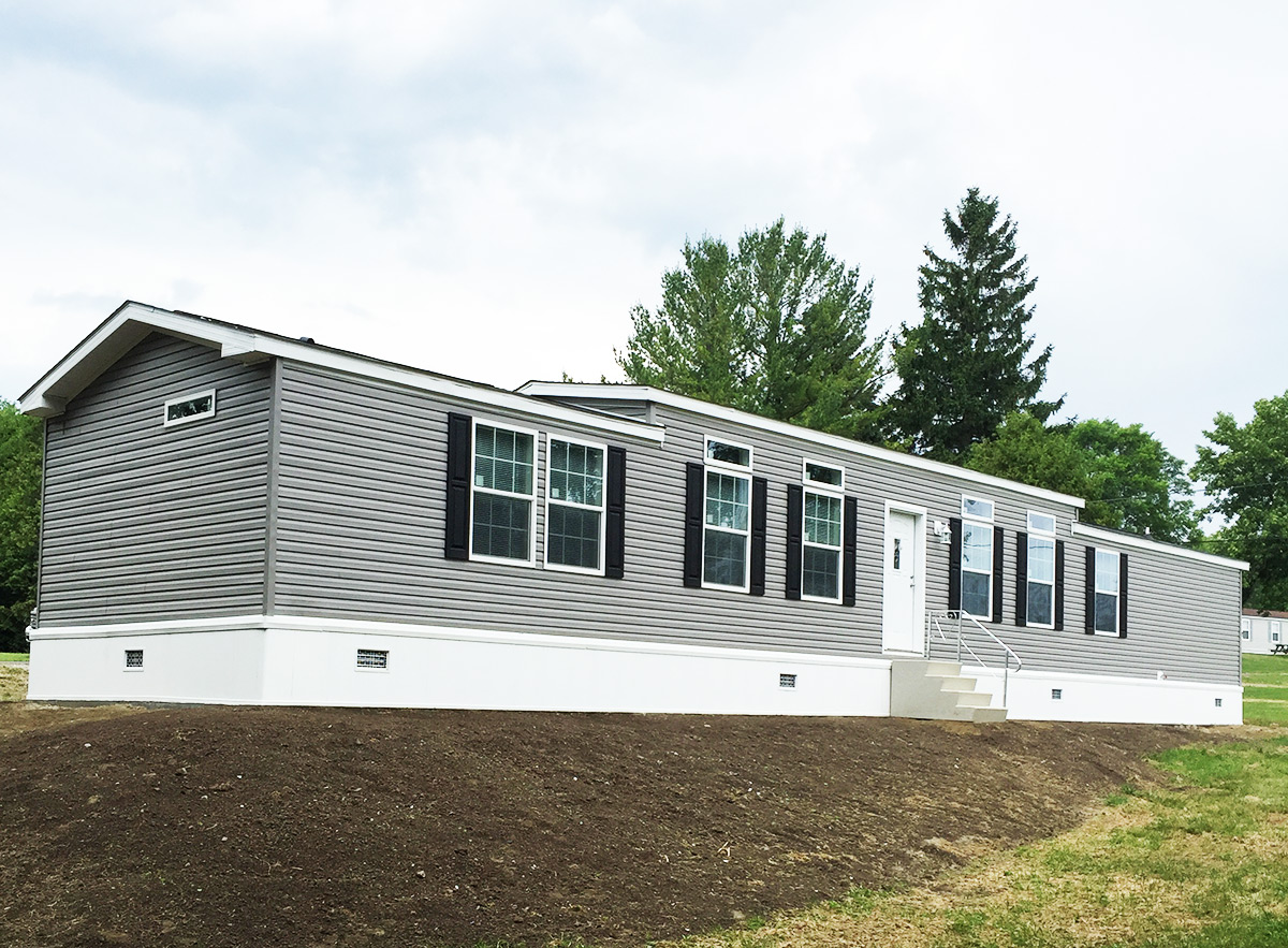 1A133A Single Wide Manufactured Home Exterior  Village