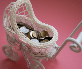 White baby carriage with coins in it