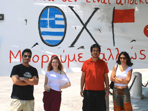 Young Greeks pose beside an Oxi banner in July.
