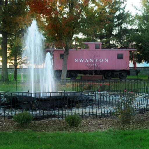 Pilliod Park fountain and caboose in the fall