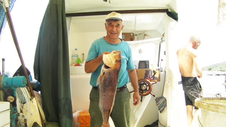Рыбалка в деревне Каллирахи, остров Тасос, Греция