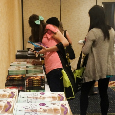 Teens loading up in the Swag Room at the Teen Day Party.