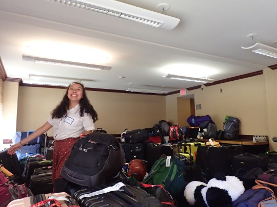 Karina traispsing through the deep, dark wood of our luggage forest.