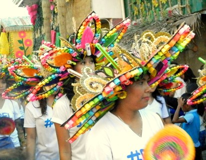 Government officials parading with colorful headdresses on.