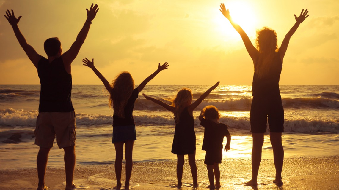 Happy family standing on the beach on the dawn time; Shutterstock ID 132280652; PO: david-today
