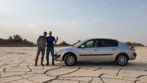 In the Shahdad Desert, Soroush and I stopped to take a picture with his car | Scenes from our Iran road trip | VincePerfetto.com