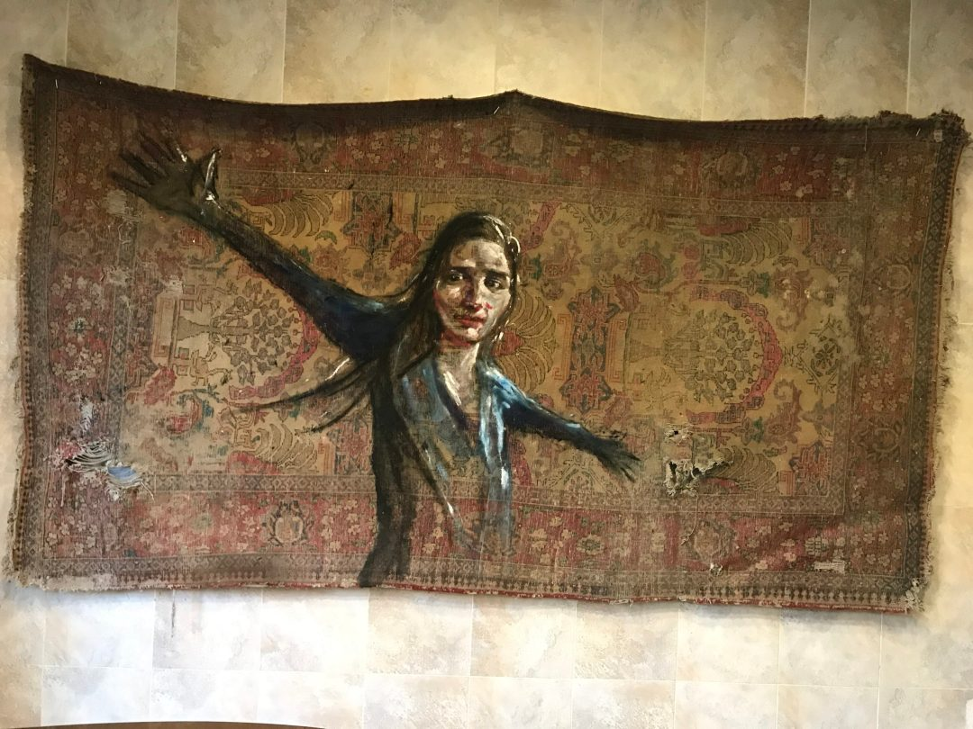 An artist in Tabriz found an old carpet and used it as a canvas for their painting.