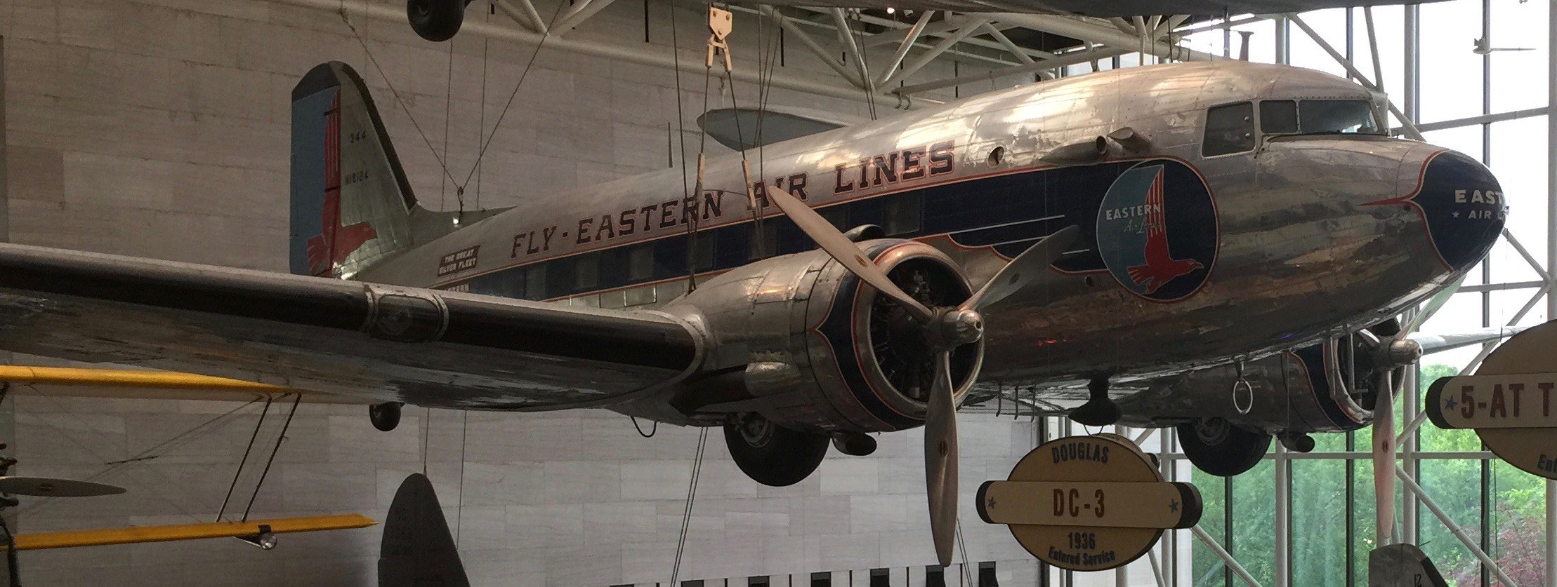A Far Eastern Airlines branded metal polished Douglas DC-3 hanging in the Smithsonian Museum