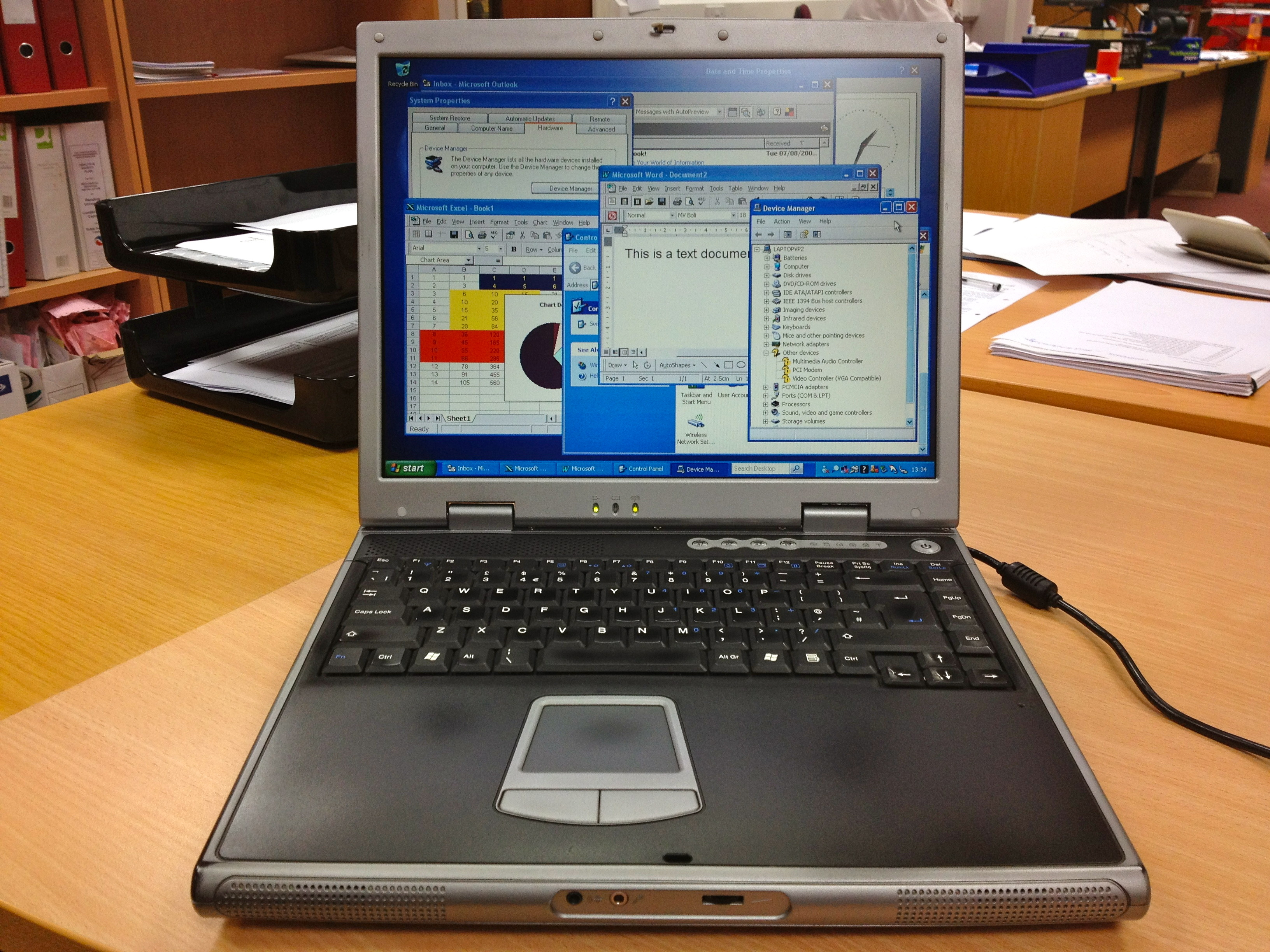A Novatech laptop opened and showing various opened windows
