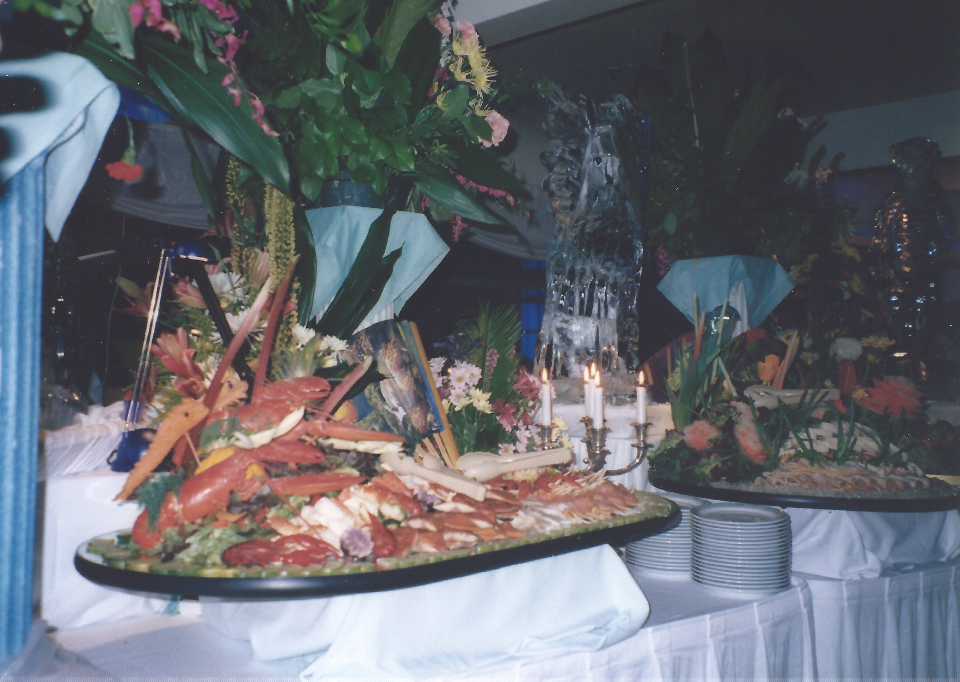 Photograph of a seafood buffet spread featuring a large lobster