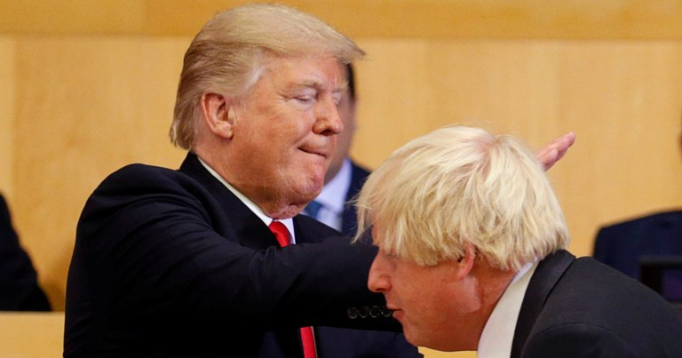 US-President-Donald-Trump-pats-British-Foreign-Secretary-Boris-Johnson-on-the-back-as-they-partici