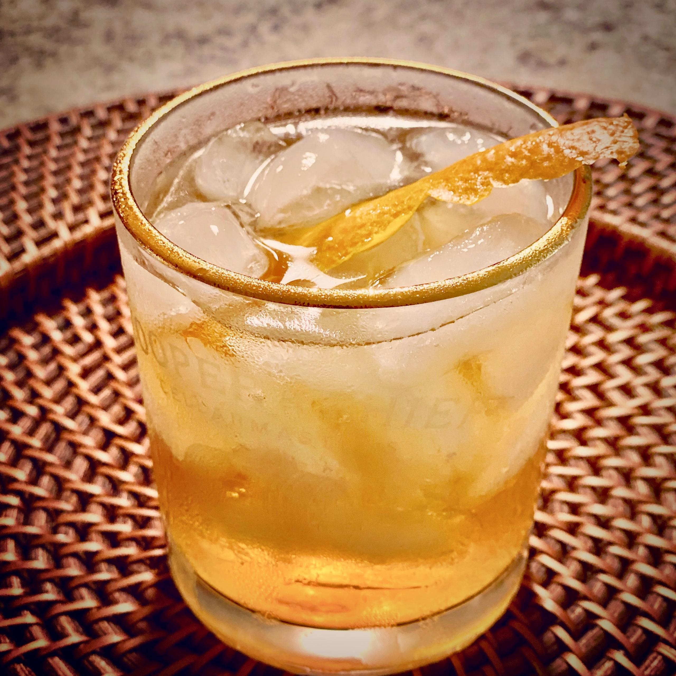 cocktail over ice with orange rind twist
