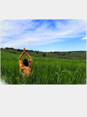 Ewa from Vine & Soul Yoga in a Field