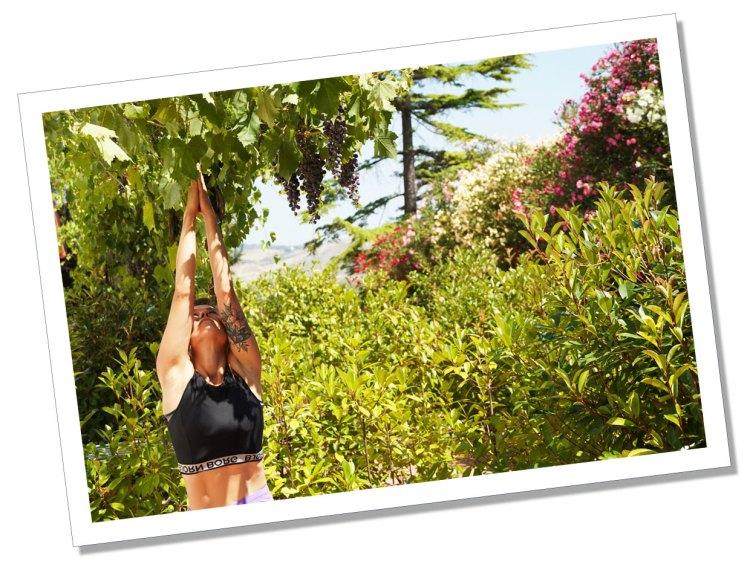 Ewa at Essentia under some wine grapes
