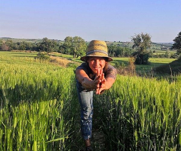 Ewa from Vine & Soul Yoga in a Field