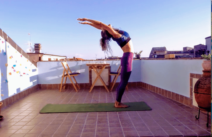 Ewa from Vine & Soul doing Yoga on the Roof