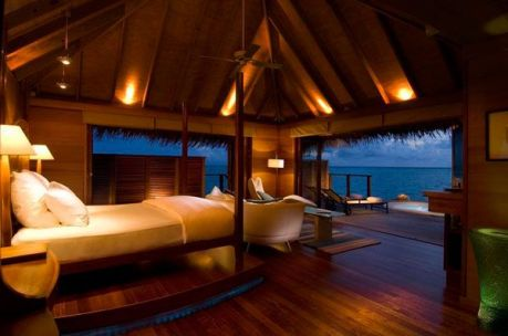 cool-ocean-view-bedroom-interior-decor-with-inspiring-lighting-and-bed-sofa-lamps-folding-glass-door-ceiling-fan-wooden-flooring-and-lounge-on-terrace-ideas