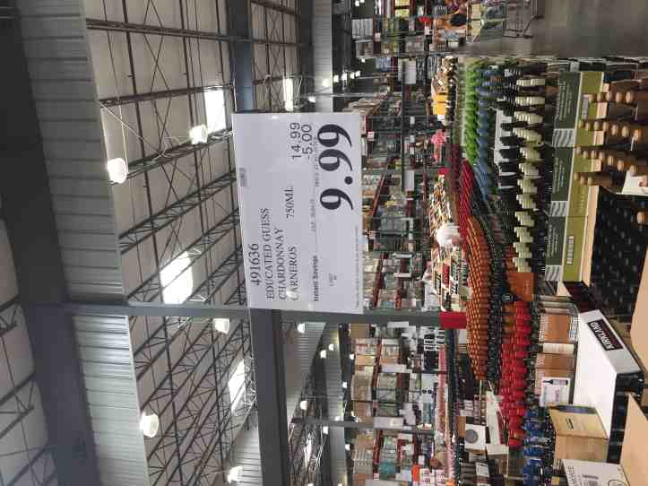 Photo of a Costco store and case stacks of wine, including Educated Guess Chardonnay at $9.99