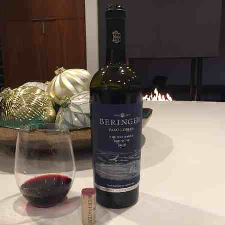 Glass and bottle of Beringer red wine, The Waymaker 2016