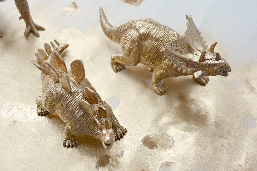 3 Dinosaurs and a Can of Gold Spray Paint - DIY Gold Dinosaur Ornaments